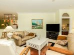 Large flatscreen TV with cable package in the open living area assures that movie night will be enjoyable.