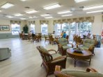 In the community room you can meet new friends, play cards, play a game, or attend an organized event or function.