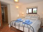 King-size bedroom with en-suite shower room with WC