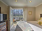 This open and airy masters suite has french doors leading to the spacious upper deck.