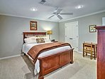 In the second bedroom,  you'll find a full bed and rustic decor.