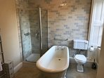 Original Victorian deep cast bath with Lefroy Brooks sanitaryware and power shower