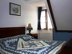 Bedroom with large double bed and lovely valley view