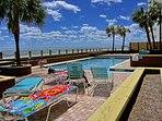 Tropical Oceanfront Pool With deck Chairs Provided