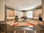 Beautiful open space kitchen with large island.