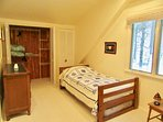Twin room adjacent to Master has two twin beds and a single mattress trundle