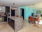 Kitchen with breakfast bar and stainless steel appliances