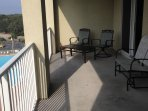 Large balcony overlooking 3 pools, Lake Stewart and Gulf of Mexico.