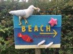 Yarn bombing - Beach sign