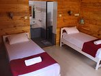 Our twin sharing log cabins with separate shower room and separate toilet.