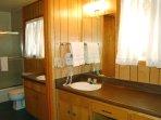 Full bathroom with long vanity