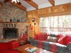 Living room with stone fireplace (wood provided in season)