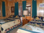 Bedroom 1 with a queen and twin beds