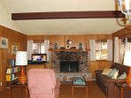 Living room with 32' flat screen TV and fireplace (wood provided in season)