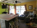 Open floor living/kitchen w/queen sofa bed, love seat, ottoman, 50 inch TV.