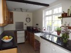 Fully equipped kitchen with cooker, microwave, fridge, freezer,  dishwasher, washing machine