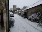 Middleham church in the snow viewed from our front door.