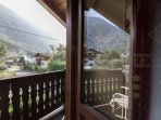 Room with balcony and mountain village view