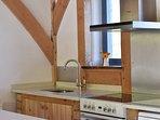 kitchen area including dishwasher, microwave and fridge freezer