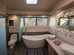 Suite #1 Bath. soaking tub and shower on left