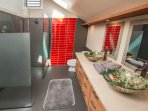 Suite #2 Bath. Beautiful plumeria and koi fish sink basins.