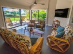 'Hawaii room' with 65' 4K TV. Watch your favorite TV while eating or cooking! Nice Ocean Views!