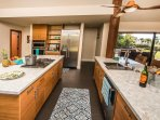 Wolf and Kitchen-Aid appliances in large professionally furnished kitchen.