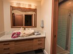 Suite #3 Bath. A piece of Kauai history! A shell sink from the Famous Coco Palms Hotel.