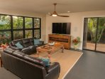 Tropical garden and ocean views while you watch the 75' 4K surround sound TV!