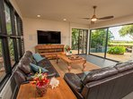Large doors and jalousie windows throughout bring tropical cooling breezes in.