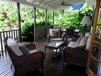 The veranda overlooks our big, lush, tropical gardens.