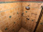The tiled, walk-in shower in the master bathroom features two separate showerheads.