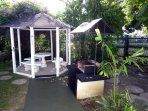 Gazebo and barbecue. The back gate leads on to the green - just across the road is the sea - 2 mins!