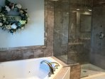Jetted tub and shower in master bathroom