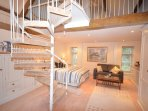 Master bedroom with a spiral staircase leading to the en-suite