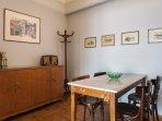 Mid-century dining room, marble table, greek artwork