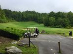 Get a bucket of balls and a cart from the club and head up to the driving range for some fun!