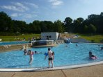 One of the nearby outdoor swimming pools with slides