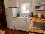 Kitchen comes fully equipped with coffee maker, blender, microwave, oven and cookware.
