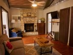 Living room equipped with fireplace, cable tv, wifi and linen closet.
