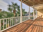 Wake up and catch the sunrise with a hot morning drink on this spacious deck.