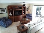 The living room with its high end furnishings, HDTV and A/C enjoys direct access to the lanai.