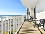Balcony is perfect for enjoying views of ocean and sunset. Seating and chaise lounge.