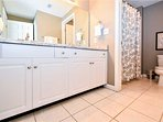 Master bath with double vanity. Shower and commode in separate room.
