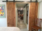 Hand crafted barn door separates the bedroom from the hall and living room