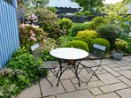 Pretty garden with table and chairs