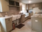 The kitchen has plenty of custom cabinets keeping with the period of construction