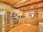 Utilize the stainless steel appliances featured in the kitchen.