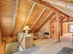 Retreat upstairs to the loft to watch the flat-screen TV.