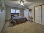 Bedroom two has a cloud-like queen bed and ample closet space for storage!